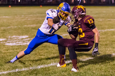 Johnsburg's Adam Jayko (12) tackles Richmond-Burton's Blaine Bayer (13) Friday, Sept. 9, 2016 at Richmond-Burton High School in Richmond. Johnsburg beats Richmond 53-0.