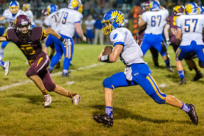 Johnsburg quarterback Riley Buchanan runs a keeper around the end and on into the endzone Friday, Sept. 9, 2016 at Richmond-Burton High School in Richmond. Johnsburg went on to win 53-0.