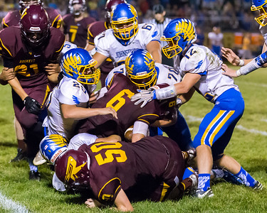 Johnsburg defender stop Richmond-Burton's Mark Marzahl (6) for a loss Friday, Sept. 9, 2016 at Richmond-Burton High School in Richmond. Johnsburg's defense shutout Richmond 53-0.