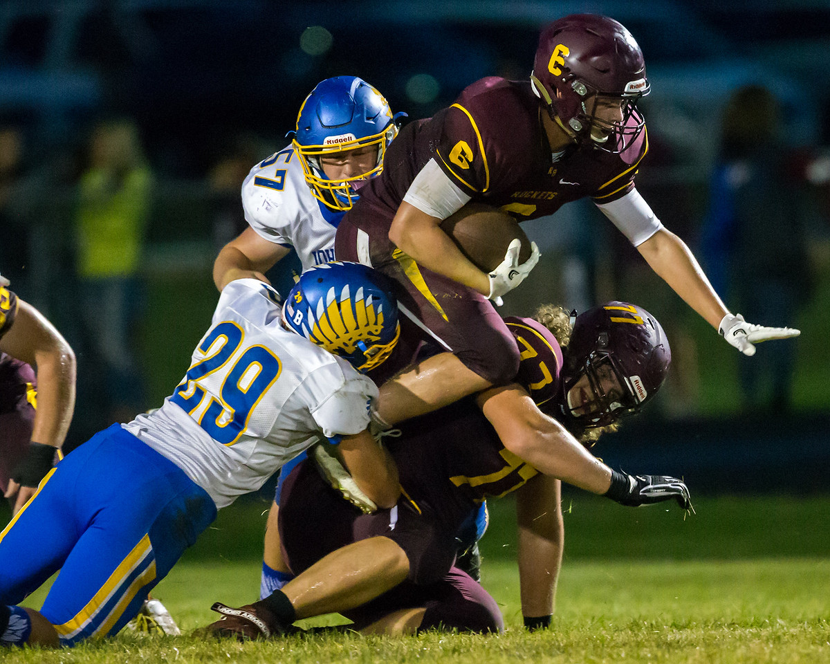 Richmond-Burton's Mark Marzahl (6) is brought down  by Johnsburg's Chuck CCurry (29) Friday, Sept. 9, 2016 at Richmond-Burton High School in Richmond. Johnsburg defeated Richmond 53-0.