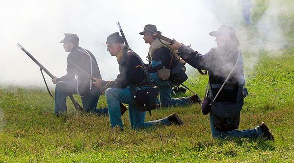 Candace H. Johnson-For Shaw Media Union soldiers with the Illinois Battalion fire upon the Confederates in a skirmish during the Civil War Re-Enactment and Battle at the Northbrook Sports Club in Hainesville.