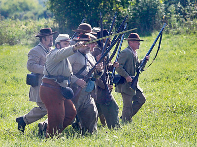 Candace H. Johnson-For Shaw Media Confederate soldiers advance while fighting Union soldiers during the Civil War Re-Enactment and Battle at the Northbrook Sports Club in Hainesville.