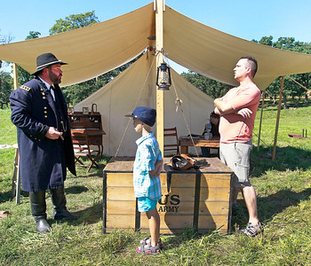 Candace H. Johnson-For Shaw Media General Ulysses S. Grant, portrayed by Wayne Issleb, of Trevor, Wis., talks to Mark Lenczycki, 7, of Grayslake and his father, Alan, during the Civil War Re-Enactment and Battle at the Northbrook Sports Club in Hainesville.