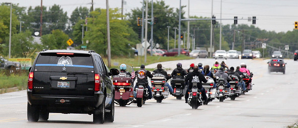 "Bikers ride down Rt 47 during the first annual Dwight ""Maddog"" Maness Veteran's Assistance Fund Motorcycle Run at Woodstock Harley-Davidson on Saturday, September 10, 2016 in Woodstock, Ill. The ride goes to the McHenry Moose Lodge where they have a pig roast fundraiser to help military veterans.  John Konstantaras photo for the Northwest Herald"