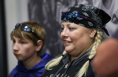 "Sue Maness waits for the start of the first annual Dwight ""Maddog"" Maness Veteran's Assistance Fund Motorcycle Run at Woodstock Harley-Davidson on Saturday, September 10, 2016 in Woodstock, Ill. The ride goes to the McHenry Moose Lodge where they have a pig roast fundraiser to help military veterans.  John Konstantaras photo for the Northwest Herald"