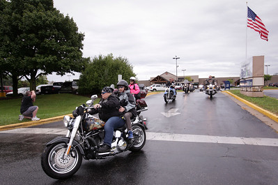 "Sue Maness leaves the parking lot as the start of the first annual Dwight ""Maddog"" Maness Veteran's Assistance Fund Motorcycle Run at Woodstock Harley-Davidson on Saturday, September 10, 2016 in Woodstock, Ill. The ride goes to the McHenry Moose Lodge where they have a pig roast fundraiser to help military veterans.  John Konstantaras photo for the Northwest Herald"
