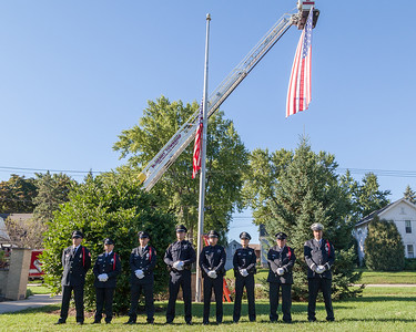 Officers and Firefighters stand at parade rest Sunday, Sept.11, 2016 at Veterans Memorial Park in McHenry during the September 11th, 2001 remembrance ceremony. KKoontz for Shaw Media