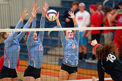 McKayla Wuensch (6), Rachel Noonan (12) and Brenna Koch (9) of Marian Central Catholic block a ball hit by a Lakes player during their second game at Marian Central Catholic High School on Monday, September 12, 2016 in Woodstock. The Hurricanes defeated the Eagles in 3 games. John Konstantaras photo for the Northwest Herald
