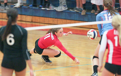 Meghan Schwallie (11) of Marian Central Catholic reaches for a dig during their third game against Lakes at Marian Central Catholic High School on Monday, September 12, 2016 in Woodstock. The Hurricanes defeated the Eagles in 3 games. John Konstantaras photo for the Northwest Herald