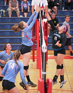 Gabrielle Davis (16) of Marian Central Catholic scores a point as she battle Rachel Orpano (8) of Lakes at the net during their first game at Marian Central Catholic High School on Monday, September 12, 2016 in Woodstock. The Hurricanes defeated the Eagles in 3 games. John Konstantaras photo for the Northwest Herald