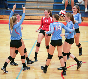Marian Central Catholic players celebrate a point late in their third game against Lakes at Marian Central Catholic High School on Monday, September 12, 2016 in Woodstock. The Hurricanes defeated the Eagles in 3 games. John Konstantaras photo for the Northwest Herald