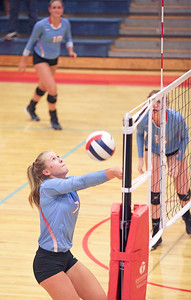 McKayla Wuensch (7) of Marian Central Catholic bumps a ball at the net during their third game against Lakes at Marian Central Catholic High School on Monday, September 12, 2016 in Woodstock. The Hurricanes defeated the Eagles in 3 games. John Konstantaras photo for the Northwest Herald