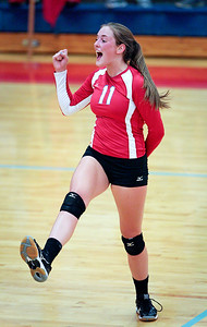 Meghan Schwallie (11) of Marian Central Catholic celebrates a point during their third game against Lakes at Marian Central Catholic High School on Monday, September 12, 2016 in Woodstock. The Hurricanes defeated the Eagles in 3 games. John Konstantaras photo for the Northwest Herald