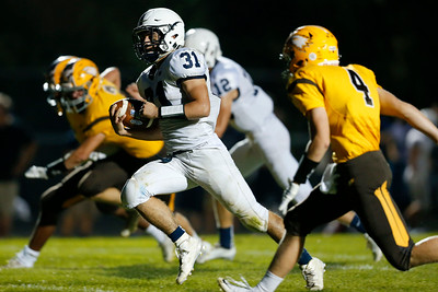 Max Skol (31) of Cary-Grove runs past Trevor Fitzsimmons (4)from Jacobs for a touchdown during the first quarter of their game at Jacobs High School on Friday, September 16, 2016 in Algonquin. The Trojans defeated the Golden Eagles 35-14.  John Konstantaras photo for the Northwest Herald