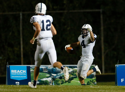 Ryan Magel (4) of Cary-Grove celebrates his touchdown run during the second quarter of their game against  Jacobs on Friday, September 16, 2016 in Algonquin. The Trojans defeated the Golden Eagles 35-14.  John Konstantaras photo for the Northwest Herald