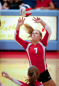 McKayla Wuensch (7) of Marian Central Catholic sets the ball during their first game against Harvest Christian at Marian Central Catholic High School on Monday, September 19, 2016 in Woodstock, Ill. The Hurricanes defeated the Lions in 2 games; 25-16, 25-19.  John Konstantaras photo for the Northwest Herald