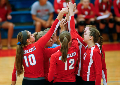 Marian Central Catholic players huddle before their game against Harvest Christian at Marian Central Catholic High School on Monday, September 19, 2016 in Woodstock, Ill. The Hurricanes defeated the Lions in 2 games; 25-16, 25-19.  John Konstantaras photo for the Northwest Herald