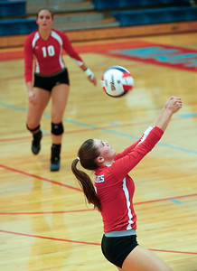 Brenna Koch (9) of Marian Central Catholic keeps the ball in play during their second game against Harvest Christian at Marian Central Catholic High School on Monday, September 19, 2016 in Woodstock, Ill. The Hurricanes defeated the Lions in 2 games; 25-16, 25-19.  John Konstantaras photo for the Northwest Herald