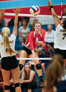 Brenna Koch (9) of Marian Central Catholic spikes the ball during their second game against Harvest Christian at Marian Central Catholic High School on Monday, September 19, 2016 in Woodstock, Ill. The Hurricanes defeated the Lions in 2 games; 25-16, 25-19.  John Konstantaras photo for the Northwest Herald