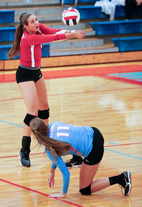 Sydney Nemtuda (10) of Marian Central Catholic bumps a ball during their second game against Harvest Christian at Marian Central Catholic High School on Monday, September 19, 2016 in Woodstock, Ill. The Hurricanes defeated the Lions in 2 games; 25-16, 25-19.  John Konstantaras photo for the Northwest Herald