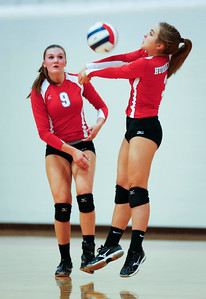 Mallory Gehrig (3) of Marian Central Catholic bumps a ball during their first game against Harvest Christian at Marian Central Catholic High School on Monday, September 19, 2016 in Woodstock, Ill. The Hurricanes defeated the Lions in 2 games; 25-16, 25-19.  John Konstantaras photo for the Northwest Herald