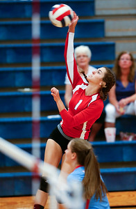Grace Biell (1) of Marian Central Catholic spikes the ball during their second game against Harvest Christian at Marian Central Catholic High School on Monday, September 19, 2016 in Woodstock, Ill. The Hurricanes defeated the Lions in 2 games; 25-16, 25-19.  John Konstantaras photo for the Northwest Herald