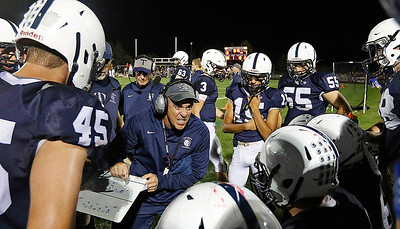 hspts_sat924_FBALL_cg_hunt_Seaburg_huddle