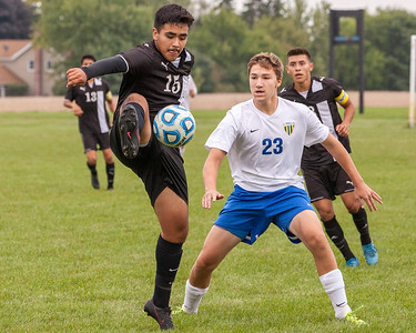 Harvard defender Marcos Morales (15) blocks a pass in front of Johnsburg midfielder Mason Sobiesk (23) Saturday, Sept. 24th 2016 at Johnsburg High School. Harvard went on to defeat Johnsburg by a score of 3-1. KKoontz – for Shaw Media