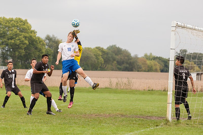 Johnsburg's Dean Wiersum (10) goes high against the Harvard defensemen, Ismael Albarran (10), Joel Juarez (17), Jesse Oros (1), Alfredo Pichardo (8) trying for the redirect Saturday, Sept. 24th 2016 at Johnsburg High School. Harvard went on to defeat Johnsburg by a score of 3-1. KKoontz – for Shaw Media