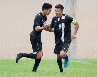 Harvard soccer captains Alfredo Pichardo (8) and Alonzo Carillo (13) celebrate following a goal scored by Carillo, Saturday, Sept. 24th 2016 at Johnsburg High School. Harvard went on to defeat Johnsburg by a score of 3-1. KKoontz – for Shaw Media