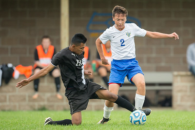 Harvard soccer defender Sergio Albarran (19) cuts off a pass intended for Johnsburg's Cody Dschida (2) Saturday, Sept. 24th 2016 at Johnsburg High School. Harvard went on to defeat Johnsburg by a score of 3-1. KKoontz – for Shaw Media