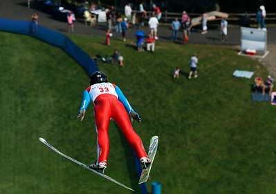 Hunter Gibson, with the Norge Ski Club flies through the air during the 31st Annual Norge Autumn Ski Jump on Sunday, September 25, 2016 in Fox River Grove. John Konstantaras – For Shaw Media