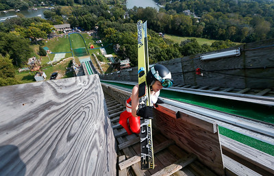 Mollie Immens, with the Norge Ski Club, climbs the ski hill during the 31st Annual Norge Autumn Ski Jump on Sunday, September 25, 2016 in Fox River Grove. John Konstantaras – For Shaw Media