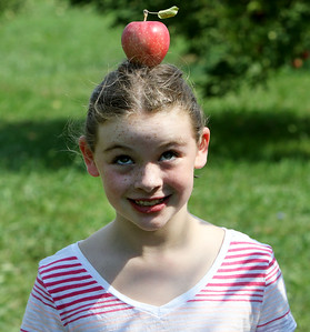 Candace H. Johnson-For Shaw Media Aileen Roach, 7, of Chicago balances an apple on her head at Ziegler's Orchard in Grayslake. Aileen was at the orchard with her parents, Mike and Meghan.