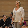 Kaneland head coach Cynthia Violett watches action on the court in the Knights' 25-13, 25-19 win Sept. 22 in Maple Park.