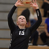 Kaneland's Shelby Hannula sets a hitter in the Knights' 25-13, 25-19 win Sept. 22 in Maple Park.