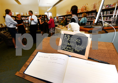 Director of the Thomas Ford Memorial Library Anne Kozak receives well wishes on her retirement