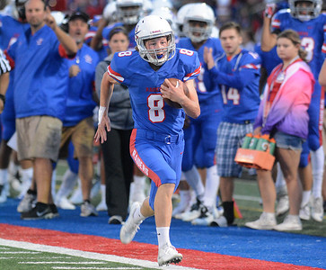Glenbard South quarterback Jack Crouch heads down the sideline for a touchdown in the first quarter of their home game Friday, Sept. 2 against Glenbard East. Mark Busch – mbusch@shawmedia.com