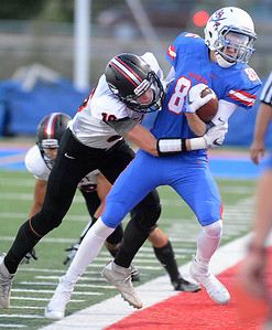 Glenbard South's TJ Springfloat tries to escape a tackle during their home game Friday, Sept. 2 against Glenbard East. Mark Busch – mbusch@shawmedia.com