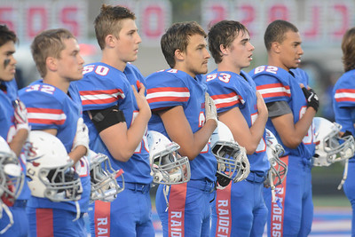 Glenbard South players show their respect during the National Anthem prior to their home game Friday, Sept. 2 against Glenbard East. Mark Busch – mbusch@shawmedia.com
