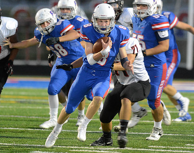 Glenbard South quarterback Jack Crouch gains good yardage during their home game Friday, Sept. 2 against Glenbard East. Mark Busch – mbusch@shawmedia.com