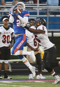 Glenbard South receiver Bryan Maroney goes up high to try and make a catch during their home game Friday, Sept. 2 against Glenbard East. Mark Busch – mbusch@shawmedia.com
