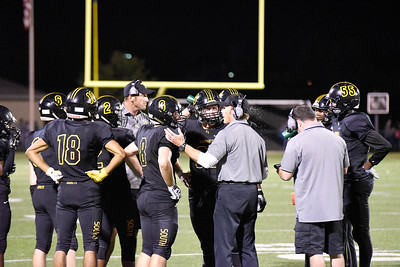 Hinsdale South coaches talk to the team during the game against Glenbard West on Friday, September 2nd. Lorae Mundt for Shaw Media