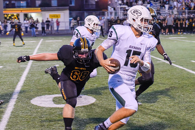 Glenbard West quarterback, Cole Brady, runs out of bounds during a play in the first quarter of the game at Hinsdale South on Friday, September 2nd. Lorae Mundt for  Shaw Media