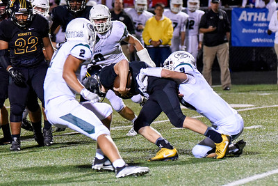 Glenbard West line backer, Chris Langan, and offensive line backer, Luke Favia, take down their opponent during the game at Hinsdale South on Friday, September 2nd. Lorae Mundt for  Shaw Media