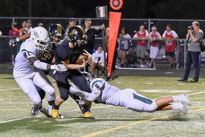 Glenbard West defense, Eric Samuta #6 and Dionte Moorehead #21 take down Hinsdale South's Brian Rudolph during the game at Hinsdale South on Friday, September 2nd. Lorae Mundt for  Shaw Media