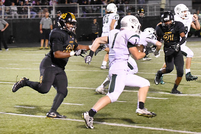 Glenbard West running back, Dominick Ficarella, runs past Hinsdale South's Deontae Curry during the game at Hinsdale South on Friday, September 2nd. Lorae Mundt for  Shaw Media