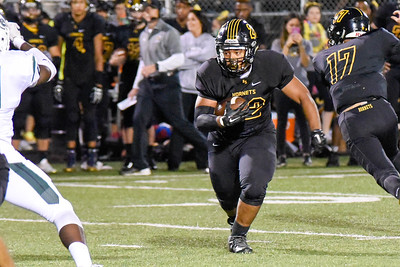 Hinsdale South  running back, Paris Lewis, gains yards during the game against Glenbard West on Friday, September 2nd. Lorae Mundt for Shaw Media