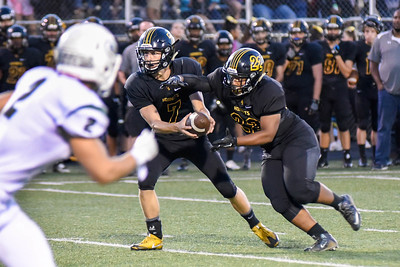 Hinsdale South quarterback, Brian Rudolph, hands off to running back, Paris Lewis, during the game against Glenbard West on Friday, September 2nd. Lorae Mundt for Shaw Media