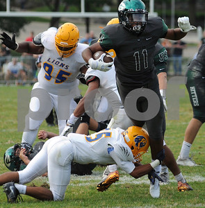 Glenbard West RB Dre Thomas,  tries to break the tackle of a Lyons Township defender. Steve Bittinger for Shaw Media